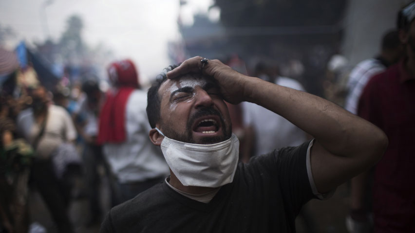 A supporter of ousted Egyptian president Mohammed Morsi reacts during clashes with Egyptian security forces in Rabaah Al-Adawiya in Cairo's Nasr City district, Egypt.