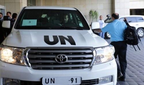 chuyên gia về vũ khí hóa học của Liên Hợp Quốc tới thủ đô Syria hôm 25/9. Ảnh: AFP.