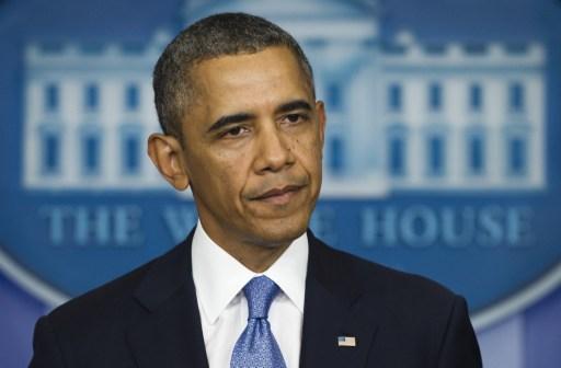 Tổng thống Mỹ Barack Obama nói về nguy cơ chính phủ phải đóng cửa trong một bài phát biểu ở Nhà Trắng hôm qua. Ảnh: AFP