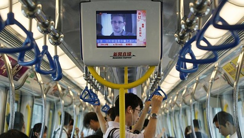 More secret documents leaked by intelligence whistleblower Edward Snowden reveal Singapore to be a key third party providing the 5-eyes group access to Malaysias communications channel. (AP Photo)