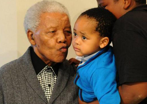 Nelson Mandela celebrates his 94th birthday with great grandchild Zesilo Hlongwane at his home in Qunu in 2012. Photo: AP