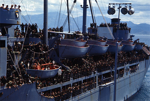 29 Jul 1965, South Vietnam --- Arrival of troop ship July 29th at Cam Ranh Bay with troops of 101st. Airborne Division crowded on decks. --- Image by © Bettmann/CORBIS