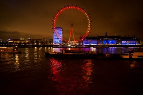 UNITED KINGDOM, London : The London Eye is lit in red and gold to celebrate the Chinese New Year in London on January 30, 2014. The Lunar New Year Year of the Horse falls on January 31 and marks the beginning of the Spring Festival holiday. AFP PHOTO/Leon Neal
