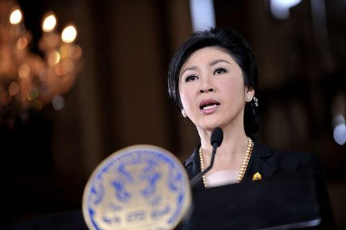 [Caption]Thủ tướng Thái Lan Yingluck Shinawatra phát biểu trong cuộc họp báo hôm 28/11 tại tòa nhà chính phủ. Ảnh:AFPcalled on anti-government demonstrators to hold dialogue with the government to find a way out of the political tumult.