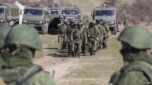 Soldiers, believed to be Russian, are stationed outside several Ukrainian army posts