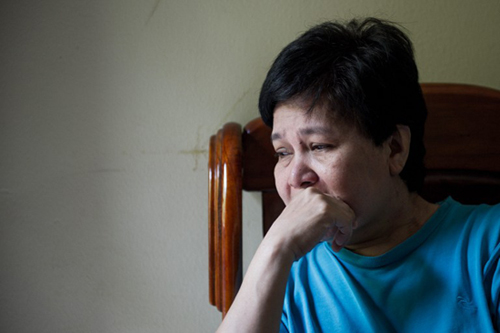 [Caption]ala Lumpur : Sarah Nor, 55, the mother of 34-year-old Norliakmar Hamid, a passenger on a missing Malaysia Airlines Boeing 777-200 plane, talks on a mobile phone at her house in Kuala Lumpur on March 8, 2014
