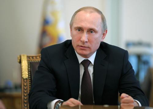 Tổng thống Putinnói rằng những nghi ngờ về sự can thiệp của Nga vào Ukraine làvô căn cứ. Ảnh: Reuters