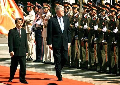 Vietnamese President Tran Duc Luong, left, and U.S. President Bill Clinton walk past Vietnamese soldiers during official welcoming ceremonies in Hanoi. Clinton's visit to Vietnam is the first by a U.S. president since 1969.