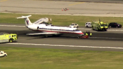 American Eagle flight 3340 was evacuated on the runway at LaGuardia Airport on July 30, 2014. (credit: CBS 2)