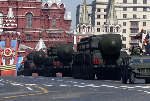 Russian mobile Topol-M missile launching units drive in formation during the Victory Day parade in Moscow's Red Square May 9, 2014. (Reuters)