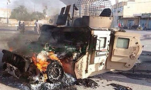 An Iraqi military vehicle burns after an attack by Islamic State militants in Anbar province last weekend. Photo: AP   Read more: http://www.smh.com.au/world/islamic-state-close-to-seizing-iraqs-anbar-province-20141010-1143v5.html#ixzz3FjB1PEes