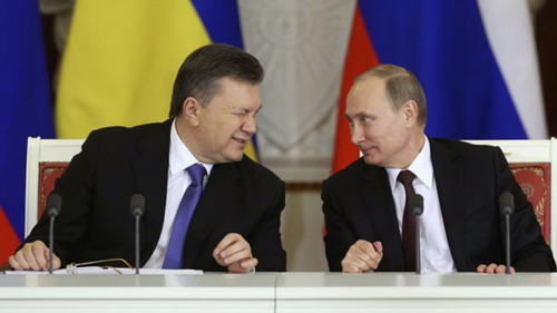 Viktor Yanukovych, left, winks in a 2013 photo to his Russian counterpart Vladimir Putin