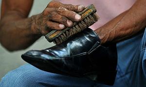 Triệu phú đánh giày ở Nam Phi