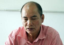 Phan Minh Quang tại công an. Ảnh: Nguyệt Triều