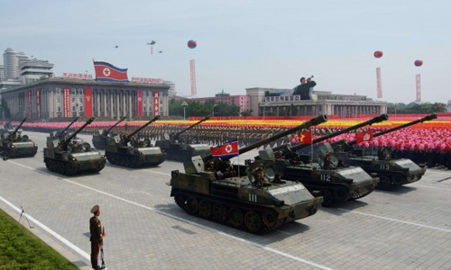 North Korean tanks pass through Kim Il-Sung square during a military parade marking the 60th anniversary of the Korean war armistice in Pyongyang on July 27, 2013. (AFP PHOTO/Ed Jones)