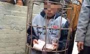 Bé trai bị nhốt vào rọ lợn vì ăn trộm tiền