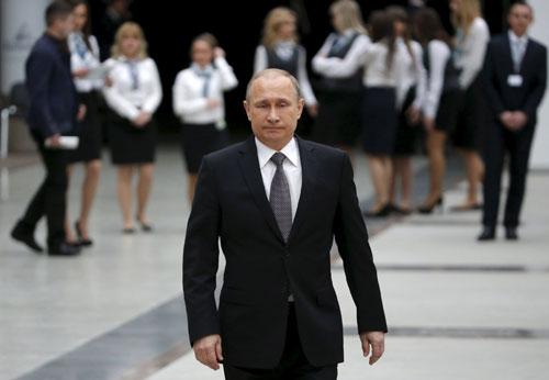Tổng thống Putin sau cuộcđối thoại thường niên hôm qua. Ảnh: Reuters