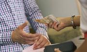 woman-giving-man-money-8072-14-7884-7329