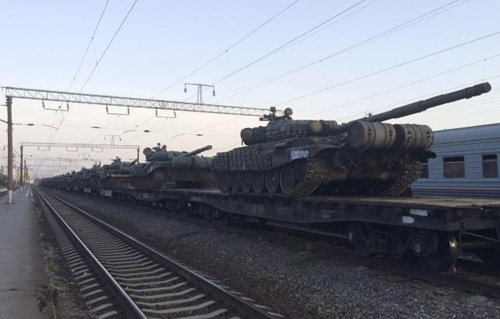 Tanks are seen on a freight train shortly after its arrival at a railway station in the Russian southern town of Matveev Kurgan, near the Russian-Ukrainian border in Rostov region, Russia, May 26, 2015. Picture taken with a mobile phone.