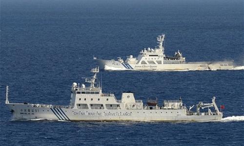 Chinese marine surveillance ship Haijian No. 51 (front) cruising as a Japan Coast Guard ship sails near the disputed islands, called Senkaku in Japan and Diaoyu in China, in the East China Sea  Photo: REUTERS