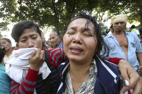 Family members cry outside at Adam Malik hospital as they wait for the bodies of victims of an Indonesian military C-130 Hercules transport plane that crashed into a residential area in the North Sumatra city of Medan,Indonesia, June 30, 2015, in this photo taken by Antara Foto. More than 100 people were feared dead after a military transport plane ploughed into a residential area shortly after take-off in northern Indonesia on Tuesday, in what may be the deadliest accident yet for an air force with a long history of crashes. REUTERS/Septianda Perdana/Antara Foto ATTENTION EDITORS - THIS IMAGE HAS BEEN SUPPLIED BY A THIRD PARTY. IT IS DISTRIBUTED, EXACTLY AS RECEIVED BY REUTERS, AS A SERVICE TO CLIENTS. MANDATORY CREDIT. INDONESIA OUT. NO COMMERCIAL OR EDITORIAL SALES IN INDONESIA.