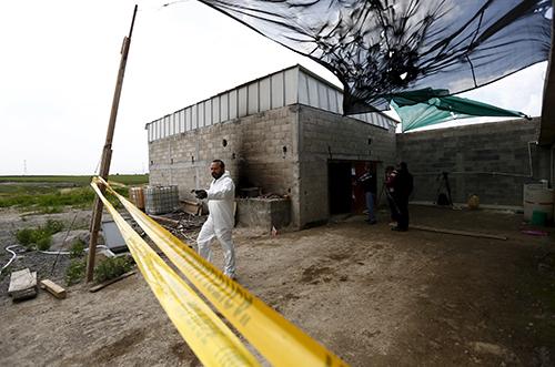 """Ngôi nhà được xây dựng gần nhà tùAltiplano từ năm ngoái để giúp """"El Chapo"""" thoát thân mà không hề bị phát hiện. Ảnh: Reuters"""