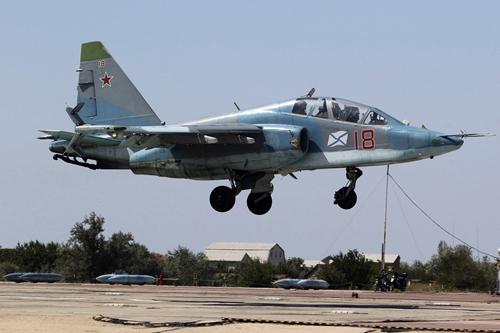 A Russian Sukhoi Su-25 jet fighter flies during a drill at a training complex in Crimea in August. Photo: Reuters