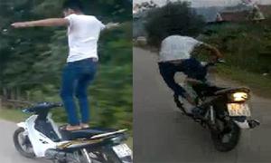 Quái xế ngã nhào vì đứng trên yên xe máy