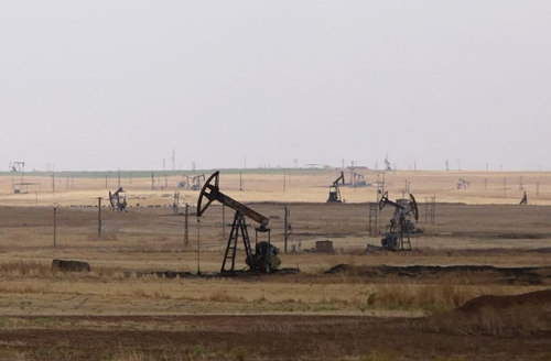 Oil well pumps are seen in the Rmeilane oil field in Syria's northeastern Hasakeh province on July 15, 2015 (AFP Photo/Youssef Karwashan)