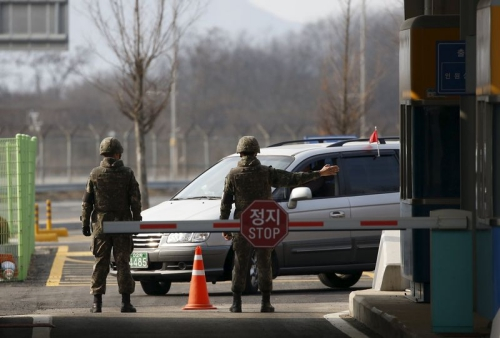 South Korean soldiers stand guard at a gateway which leads to the Kaesong Industrial Complex at the South's Customs, Immigration and Quarantine, ...