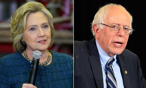 Cựu ngoại trưởng Mỹ Hillary Clinton (trái) và thượng nghị sĩ bang Vermont Bernie Sanders, hai ứng viên tổng thống đảng Dân chủ. Ảnh: AP.