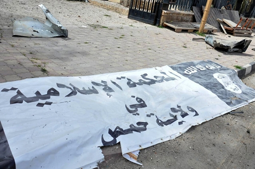 A banner belonging to the Islamic court of the Islamic State is seen on the ground after forces loyal to Syria's President Bashar al-Assad recaptured Palmyra city, in Homs Governorate in this handout picture provided by SANA on March 27, 2016. REUTERS/SANA/Handout via Reuters ATTENTION EDITORS - THIS PICTURE WAS PROVIDED BY A THIRD PARTY. REUTERS IS UNABLE TO INDEPENDENTLY VERIFY THE AUTHENTICITY, CONTENT, LOCATION OR DATE OF THIS IMAGE. FOR EDITORIAL USE ONLY. NOT FOR SALE FOR MARKETING OR ADVERTISING CAMPAIGNS. THIS PICTURE IS DISTRIBUTED EXACTLY AS RECEIVED BY REUTERS, AS A SERVICE TO CLIENTS