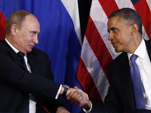 Tổng thống Nga Vladimir Putin và người đồng cấp Mỹ Barack Obama. Ảnh: Reuters
