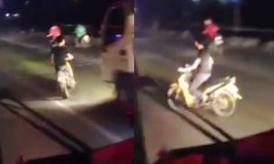 Quái xế đầu trần chạy xe máy đánh võng chặn đầu ôtô
