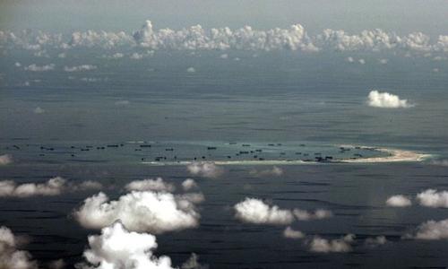 Trung Quốc bồi lấp, cải tạo trái phép đảo nhân tạo tại Trường Sa của Việt Nam. Ảnh: AFP.