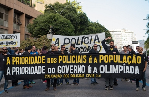 """Civil police officers threatening to go on strike demonstrate against the government for arrears in their salary payments, in Rio de Janeiro, Brazil, June 27, 2016, t Earlier this month, Rio state authorities declared a """"state of public calamity"""" over a major budget crisis in order to release emergency funds to finance the Olympic Games due to begin in August."""
