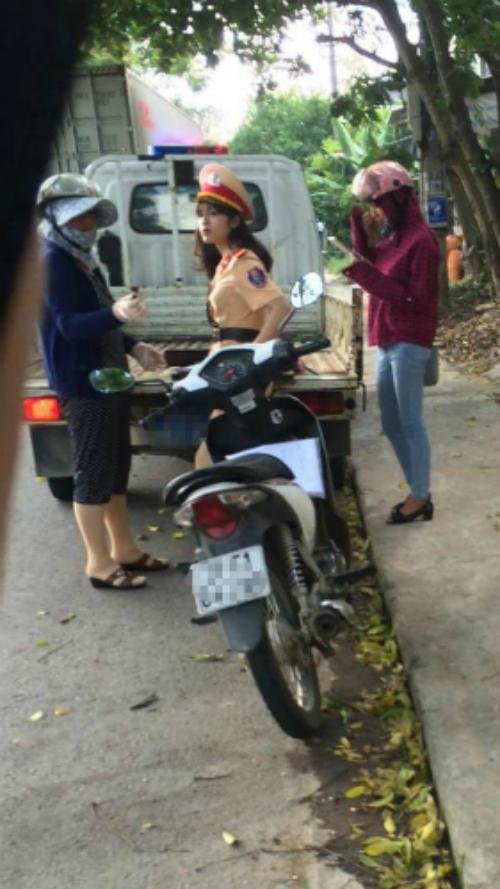 Bức ảnh của một nữ cảnh sát giao thông Yên Bái khi được chia sẻ đã gây xôn xao Facebook, và sau đó người trong ảnh gặp phiền toái.