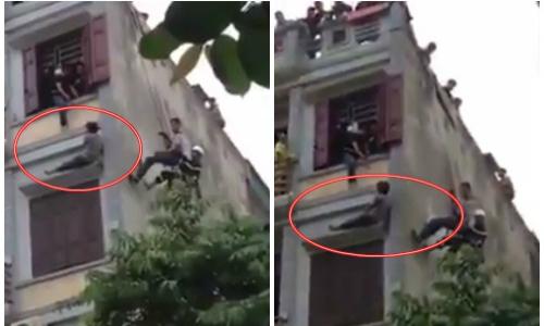 Cảnh sát đu dây giải cứu người đàn ông nhảy lầu tự tử.
