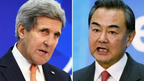 Ngoại trưởng Mỹ John Kerry và người đồng cấp Trung Quốc Vương Nghị. Ảnh: AFP, Xinhua