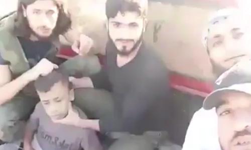phien-quan-syria-chat-dau-be-trai-nghi-la-gian-diep