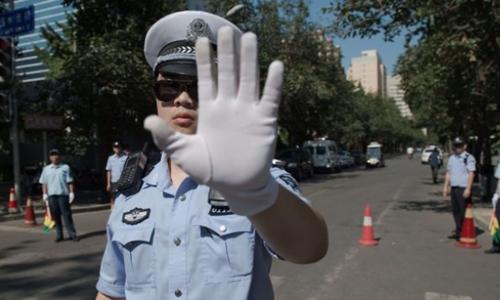 Cảnh sát Trung Quốc tại Bắc Kinh. Ảnh: AFP.