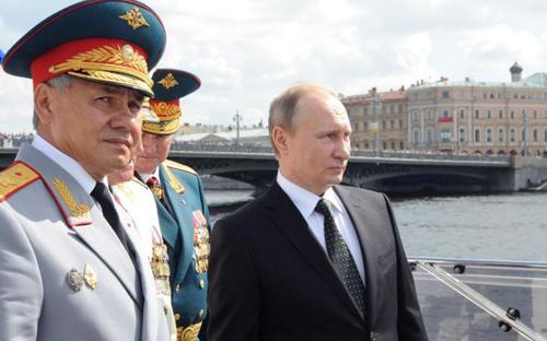 [Sergei Shoigu, left, and Vladimir Putin attend Russias Navy Day in St Petersburg last monthCREDIT:MIKHAIL KLIMENTIEV/AFP/GETTY IMAGES