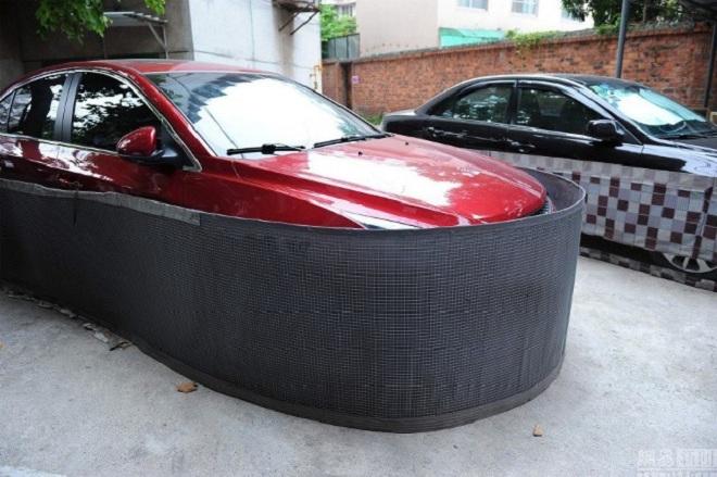 Dân Trung Quốc mặc 'váy' cho xe ôtô để chống chuột
