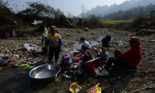 Hàng triệu người Trung Quốc vẫn đang sống trong tình trạng đói nghèo. Ảnh: AFP.