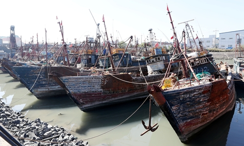 Chinese fishing boats captured by South Korean coast guard are seen at a port in Incheon, South Korea, October 10, 2016.