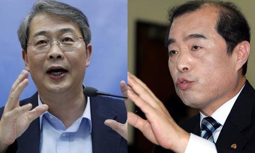 Ông Yim Jong-yong (trái) và Kim Byong-joon. Ảnh: Reuters.