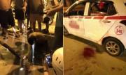 Dân vây bắt kẻ cứa cổ tài xế cướp taxi