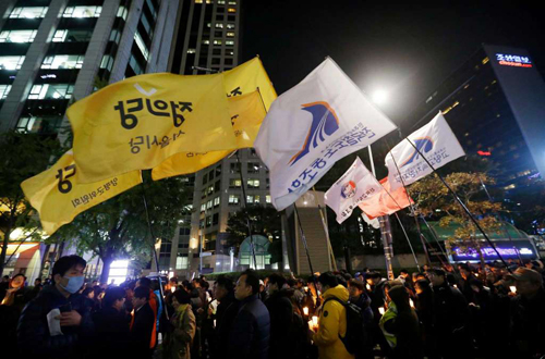 South Korean protesters march after a rally calling for President Park Geun-hye to step down in downtown Seoul, South Korea, Tuesday, Nov. 1, 2016