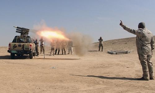 Quân đội Iraq tấn công IS ở ngoại vi thành phố Mosul. Ảnh: Sputnik.