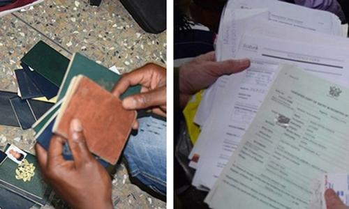 Ghana thu giữ hơn 150 hộ chiếu và giấy tờ khác tại đại sứ quán Mỹ giả. Ảnh: CNN.